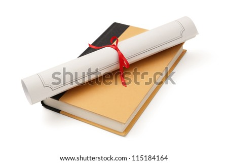 Diploma over book - stock photo