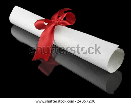 Diploma with a red silk ribbon, isolated on black background.