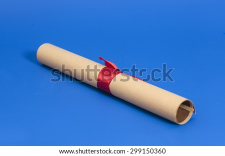Diploma with Red Ribbon on blue background - stock photo