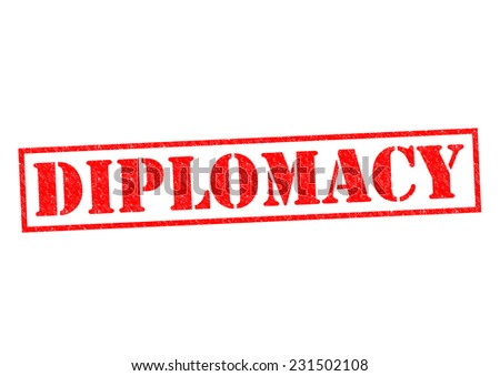 DIPLOMACY red Rubber Stamp over a white background. - stock photo