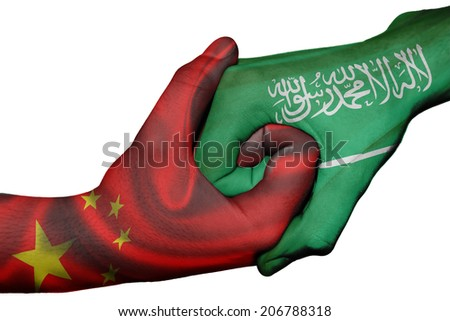 Diplomatic handshake between countries: flags of China and Saudi Arabia overprinted the two hands - stock photo