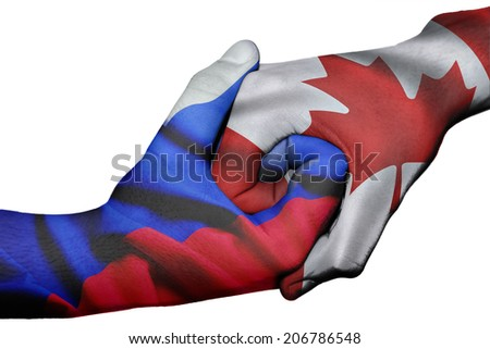 Diplomatic handshake between countries: flags of Russia and Canada overprinted the two hands - stock photo