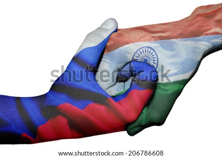 Diplomatic handshake between countries: flags of Russia and India overprinted the two hands - stock photo