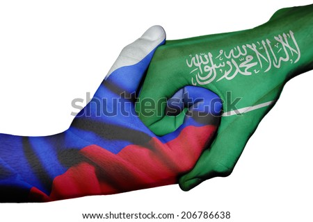 Diplomatic handshake between countries: flags of Russia and Saudi Arabia overprinted the two hands - stock photo
