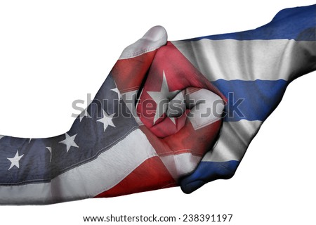 Diplomatic handshake between countries: flags of United States and Cuba overprinted the two hands