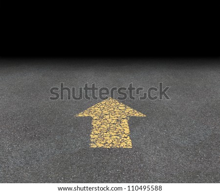 Direction Arrow on an asphalt street with an old fading yellow painted road symbol pointing into the black blank perspective as aspirations and financial success vision of strategy and goals. - stock photo
