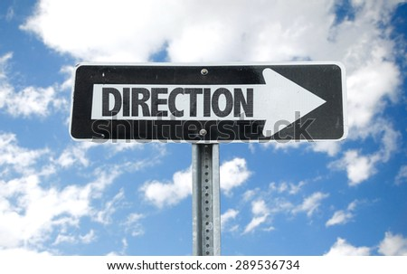Direction direction sign with sky background - stock photo