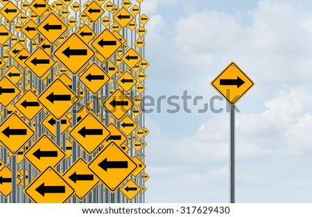 Direction individuality and independent thinking concept as a group of directional arrow traffic signs with one individual pointing in the opposite way as a business icon for innovative solution. - stock photo