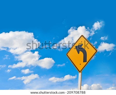 Direction sign- left turn warning on blue sky background