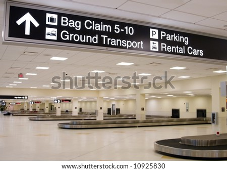 Direction signs in an airport terminal for travelers - stock photo