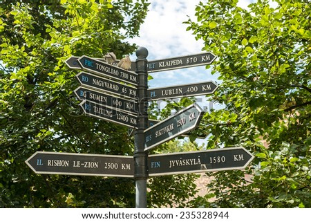 Direction Signs Indicate Distances To Different Cities From Debrecen, Hungary. - stock photo