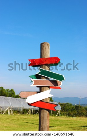 Direction Signs on blue sky - stock photo
