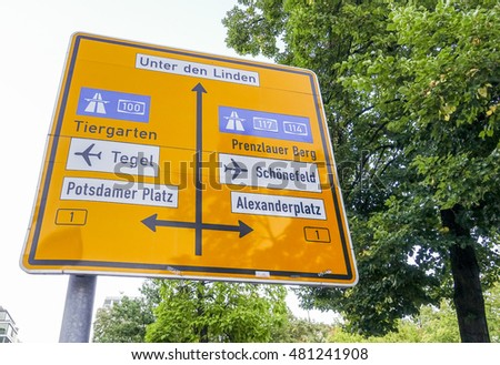 Direction signs to famous districts in Berlin - BERLIN / GERMANY - AUGUST  31, 2016