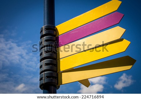 Direction signs with blue sky - stock photo
