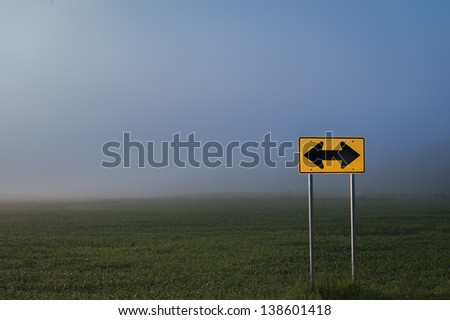 Directional road sign in front of a corn field, Stowe, Vermont, USA - stock photo