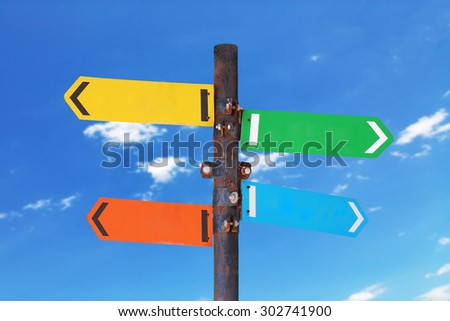 directional signs with blue sky background - stock photo