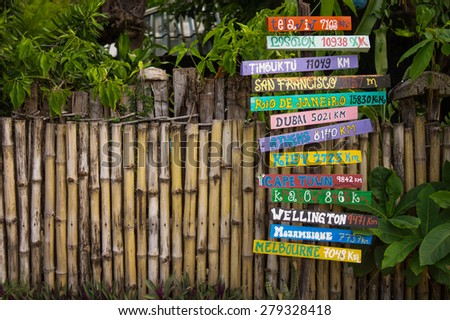 Directions with distance to cities of the World. Tropical background - stock photo
