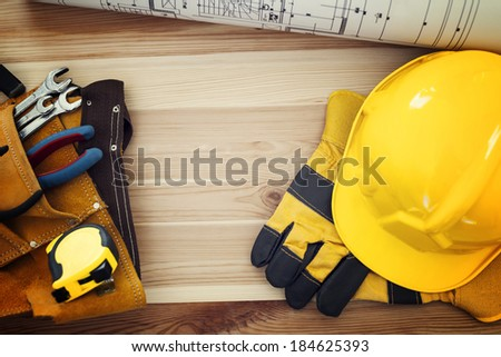 Directly above of table with work tools