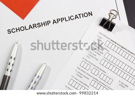 Directly above photograph of a scholarship application. - stock photo