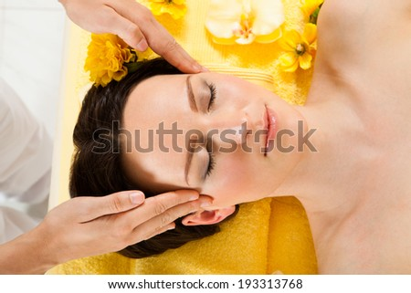 Directly above shot of beautiful woman receiving head massage in spa - stock photo