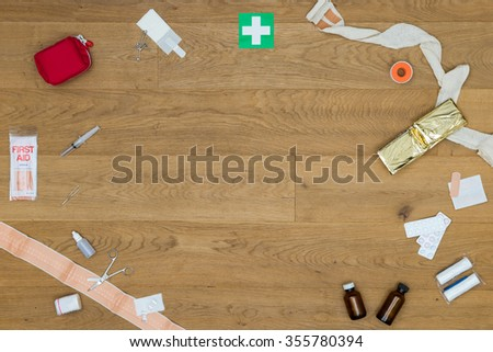 Directly above shot of first aid medical tools on wooden table - stock photo