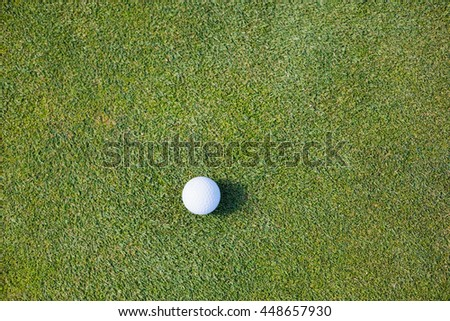 Directly above shot of golf ball on field