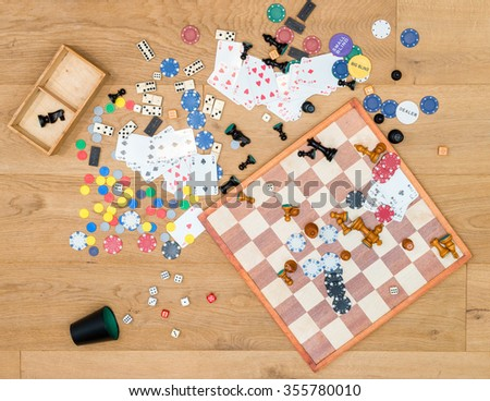 Directly above shot of various leisure games spread on wooden table - stock photo