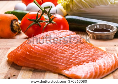directly above  top view of Fresh salmon fillet with eggs and tomato and other vegetable