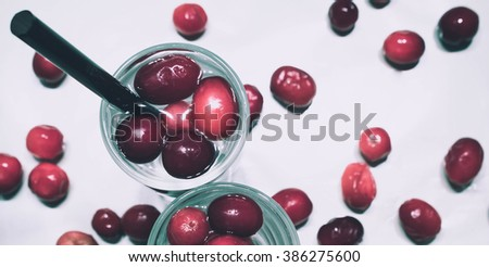 Directly above view of drinks with red berries on a white background