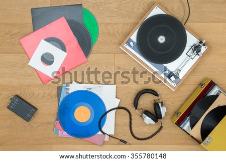 Directly above view of various records with turntable and headphones on table - stock photo