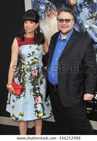 Director Guillermo del Toro & wife Lorenza Newton at the premiere of his new movie Pacific Rim at the Dolby Theatre, Hollywood. July 9, 2013  Los Angeles, CA - stock photo