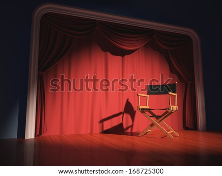 Director's chair on the stage illuminated by floodlights. - stock photo