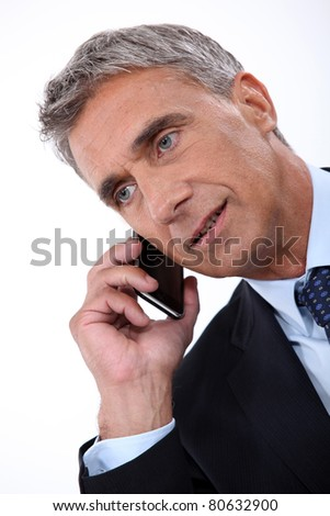 Director talking on phone on white background - stock photo