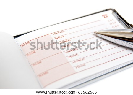 directory and pen isolated on white background