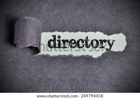 directory word under torn black sugar paper  - stock photo