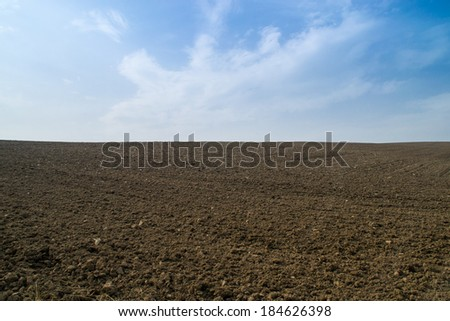 Dirt field ready for spring planting. - stock photo