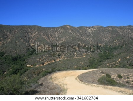 Dirt fire road in the mountains, California - stock photo