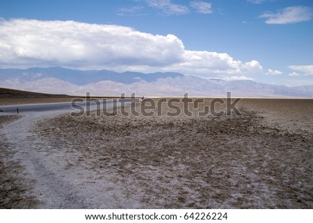 Dirt road across the salt flats of Badwater Basin, Death Valley National Park