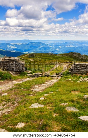Dirt road and ruin of stone wall on the top of Pip Ivan mountain in Carpathians, nature landscape, Ukraine