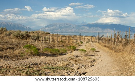 Dirt road in a very rural scene with a mountain landscape