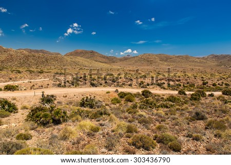 Dirt road in Cabo de Gata National Park, Andalusia, Spain - stock photo