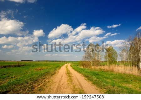 Dirt Road in Countryside - stock photo