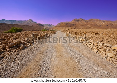 Dirt Road in Sand Hills of Samaria, Israel. Sunset - stock photo
