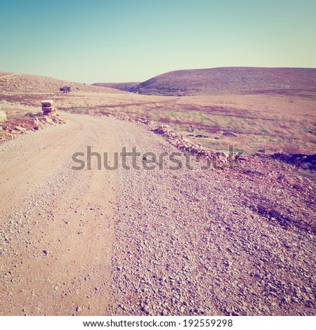 Dirt Road in the Judean Mountains in Israel, Instagram Effect - stock photo