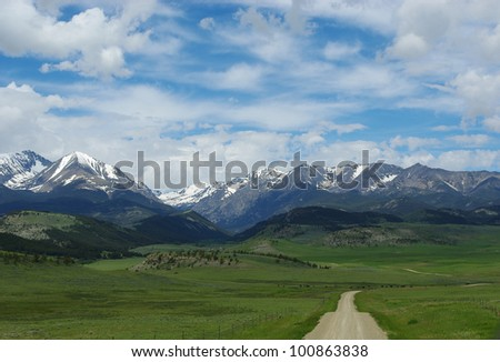 Dirt road to Bridger Range, Gallatin National Forest, Montana - stock photo