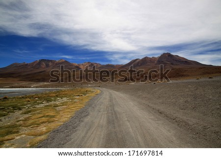 Dirt Road to Lagoon Canapa in Bolivia, South America. Uyuni Salt Flat tours,  Laguna de Canapa  - stock photo