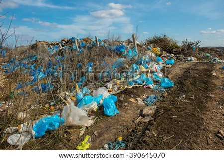 Dirt road to the landfill of household waste - stock photo