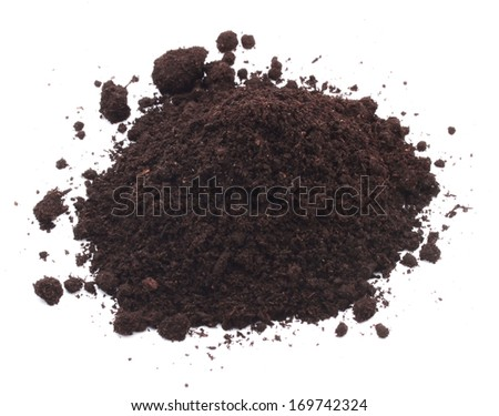 Dirt soil heap on white background - stock photo