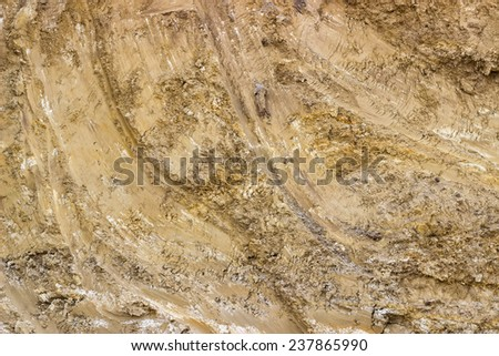 Dirt texture background, with small rocks and dust. Excavation dirt texture exposed. - stock photo