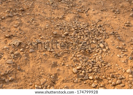 dirt texture, dirt texture with small rocks and dust in brown colour - stock photo